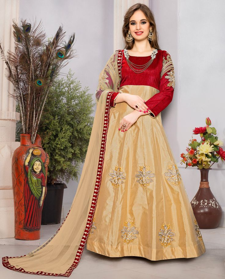 1. Red and beige taffeta silk suit 2. Heavy embroidery work on sleeve and floral 3. Comes with a matching santoon bottom and net dupatta 4. Jewellery is part of shooting not comes with dress 5. Can be stitched upto size 42 inches