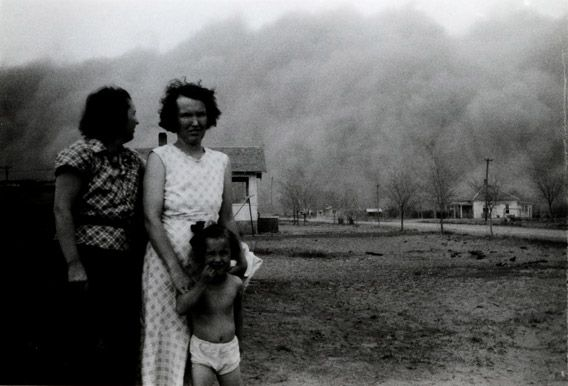 """Watching a Dust Storm's Approach,"" as a black blizzard rolls in to Ulysses, Kansas, two women and a girl pose for a photograph before taking shelter."