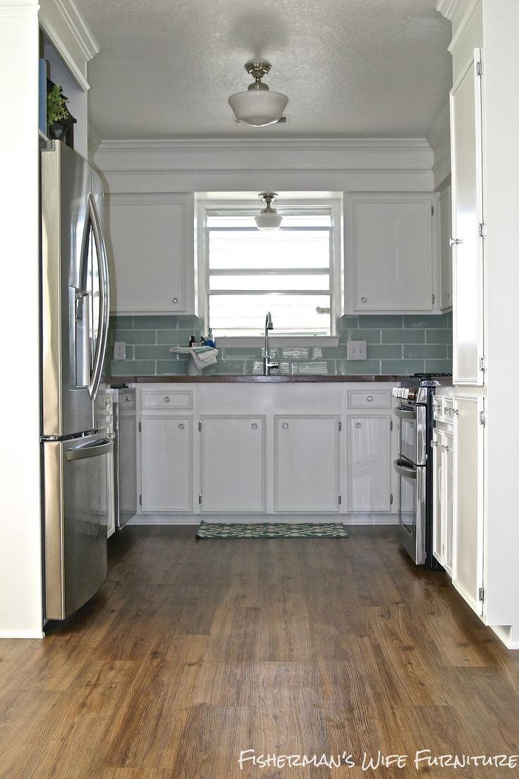 Small white kitchen makeover with built in fridge for White kitchen vinyl floor