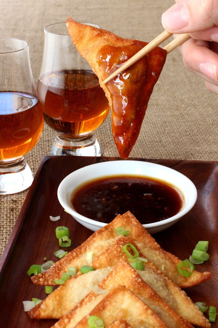 Whiskey Glazed Fried Dumplings are a crispy, fried wonton filled with ground turkey, bacon and cream cheese then dipped in a delicious whiskey glaze!