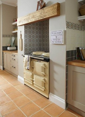 Tiles alcove for aga, with plain tiles by worktops. Could have a theme going....