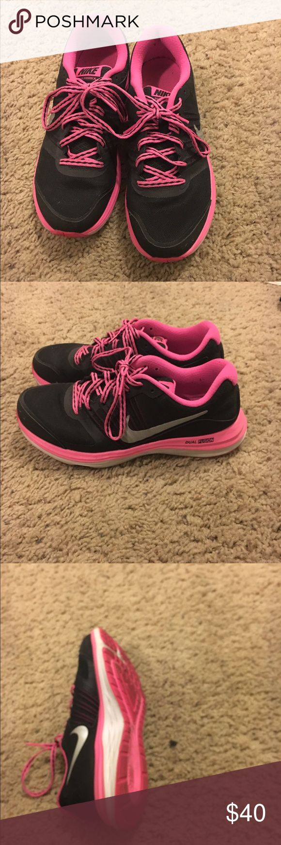 Nike dual fusion x Worn once to the gym Nike dual fusion x shoes. Bought in youth size 5.5 but are same as size 7 women's. Great condition. Too big for me. Nike Shoes Athletic Shoes