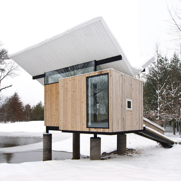 In Champaign, Illinois, this cedar hut by architect Jeffrey Poss is designed as a raised platform accessible through a ramp. Inside are grass tatami mats, a miniature tea cabinet in a tokonoma alcove, and an oversized window that frames views of the trees.