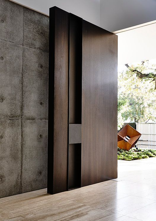 floor to ceiling contemporary door, concrete, by Workroom                                                                                                                                                                                 More