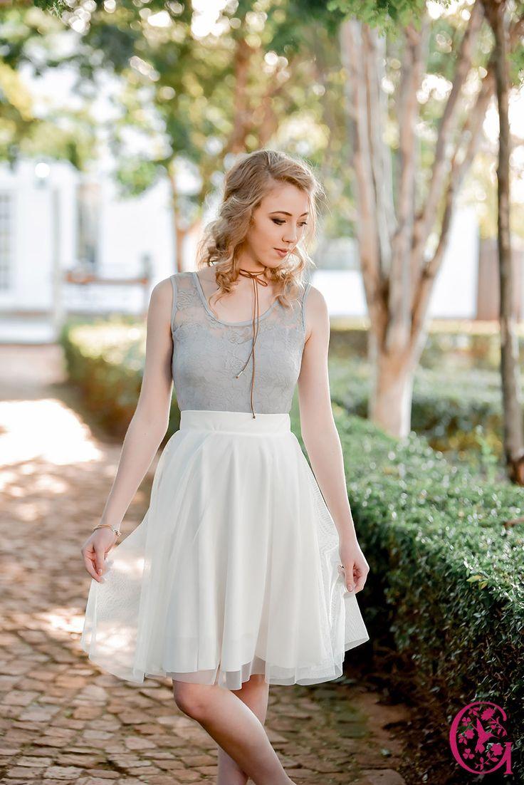 A short Gelique 1 Layer Anna skirt, worn with a Gelique Daisy Body Suit.