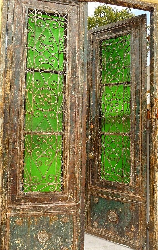 Gorgeous doors - green lead glass, wrought iron scroll work and aged to a fine patina wood