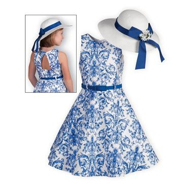 Sleeveless swing style dress of cotton/spandex with royal blue print against a bright white background. Full swing skirt. Coordinating cloth belt acce