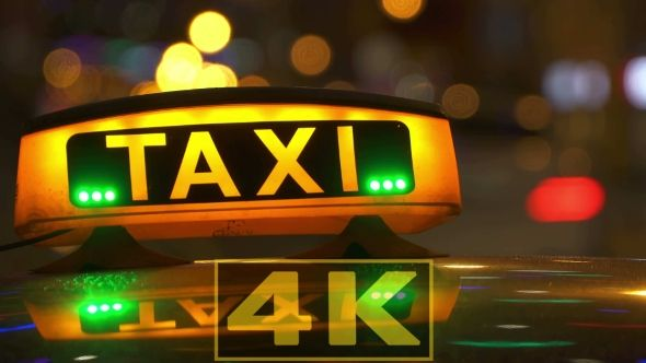 Illuminated Sign Of Taxi Cab In Night City Blurred by Celesta8 Night