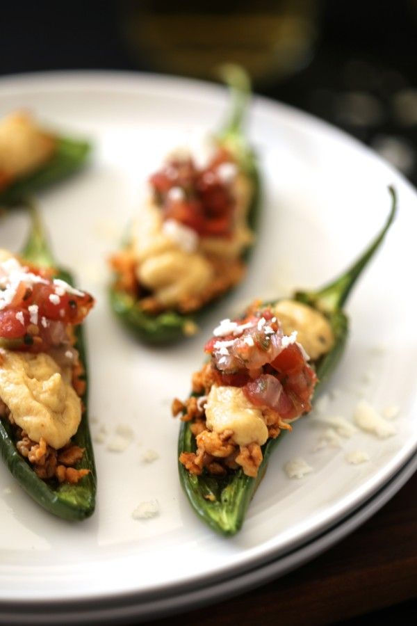 mexican spiced hummus stuffed jalapeños with chorizo & cotija cheese