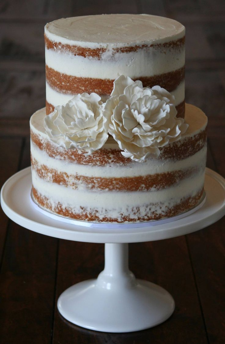 Beautiful semi-naked cake with white sugar peony's.