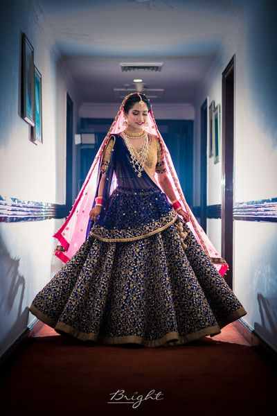 Bridal Lehenga - Navy Blue Wedding Lehenga with Golden Embroidery | WedMeGood | Big Flare Lehenga with Double Dupatta, Pink and Blue with a Beige Choli and Satlada Haar #wedmegood #indianbride #wedding