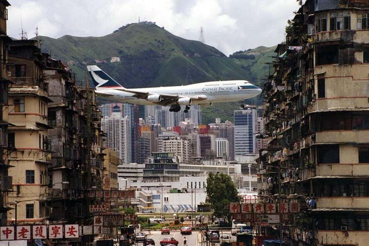 Before Hong Kong's current airport was built on Lantau Island, travelers flew right into Kowloon surrounded by skyscrapers. Planes had to fly straight towards a hill and then make a sharp turn right before landing, making for one of the most dramatic landings in the world for a major city.