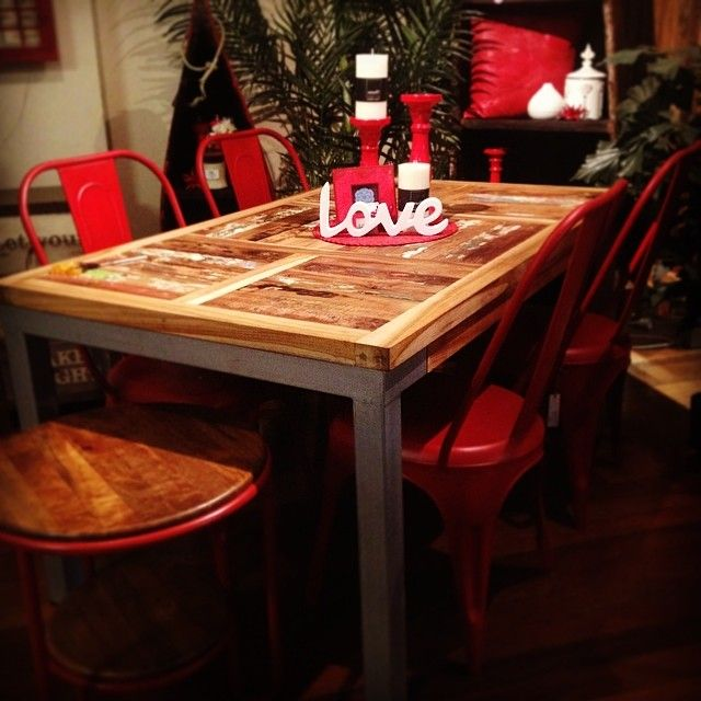 'Prahu' dining table made from recycled fishing boat timber, with red 'Pop' chairs