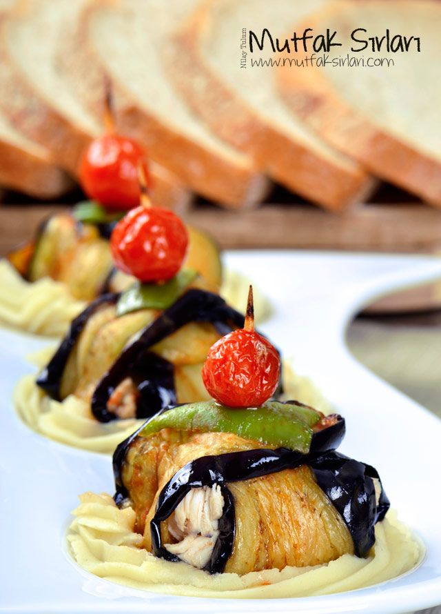 Chicken rolled in eggplant on puree Tavuklu İslim Kebabı