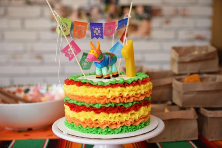 Mexican Fiesta-inspired, piñata cake topper. Available at: https://www.aymujershop.com/products/cake-topper-fiesta