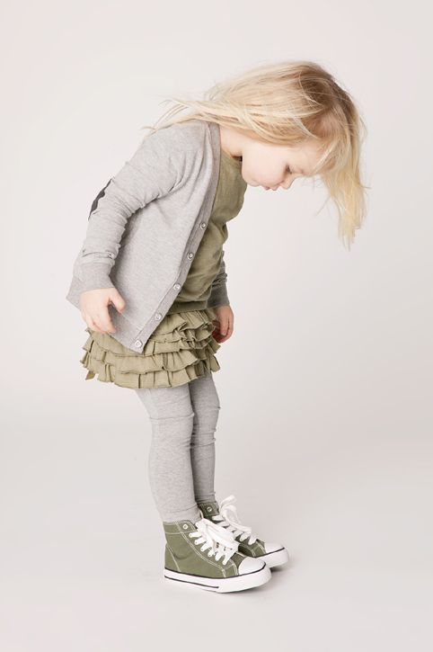 this is what my little girl would look like. Ruffled skirt for Daddy. Grey and Converse for Mommy....