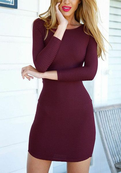 Front view of model in burgundy crisscross back bodycon dress