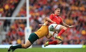 Australia's Drew Mitchell tackles Wales' Gareth Anscombe.