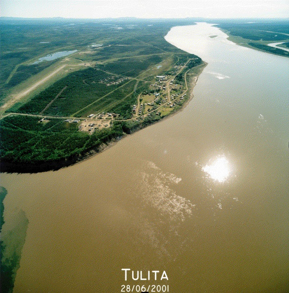 """Tulita, which in Dene language means """"where the rivers or waters meet,"""" is a hamlet in the Sahtu Region of the Northwest Territories, Canada. It was formerly known as Fort Norman, until 1 January 1996. It is located at the junction of the Great Bear River and the Mackenzie River; the Bear originates at Great Bear Lake adjacent to Deline.  Tulita is in an area that is forested and well south of the tree line. Permafrost underlays the area, more or less continuous in distribution."""