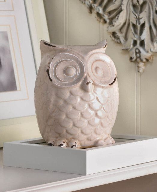 I like the distressing on this ceramic owl. I think I could do this on mine with a fun color that matches the curtains.