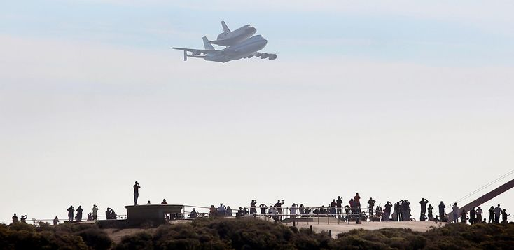The Space Shuttle Endeavour atop a modified 747 flies by the north tower over the Marin Headlands at the Golden Gate Bridge in San Francisco, Friday Sept. 21, 2012. Endeavour is making a final trek across the country to the California Science Center in Los Angeles, where it will be permanently displayed. (AP Photo/The Press Democrat, Kent Porter)