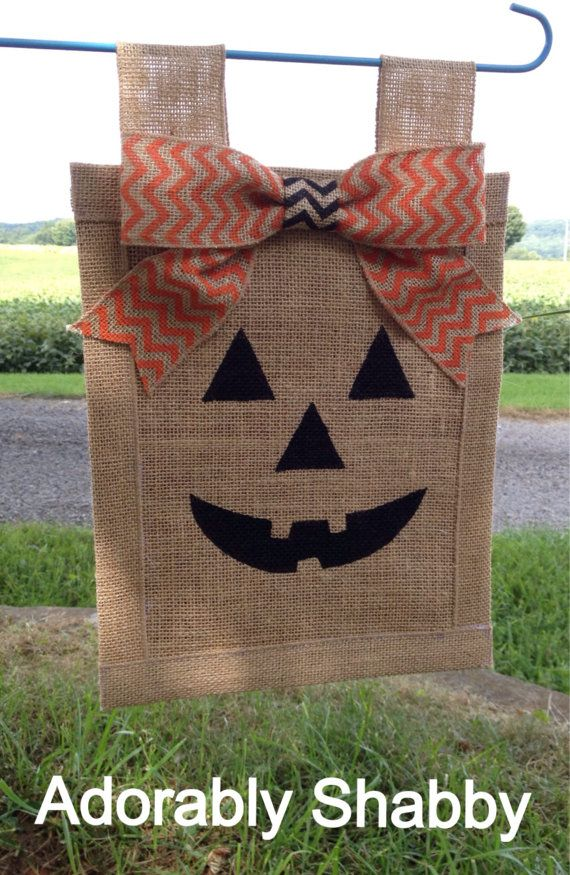 This adorable Jack O Lantern Burlap Flag is sure to put a smile on your face! Even better, it is complete with a cute orange and black chevron