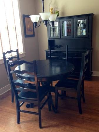 market includes black pedestal table with 4 chairs and hutch table