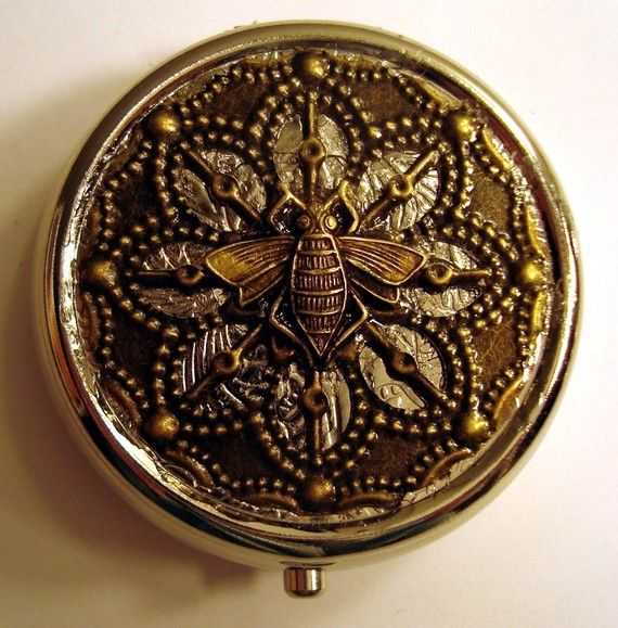 ~The Brass Bee Steampunk Victorian Pill Case or Trinket Box~   This is a silver-tone metal box adorned with an antiqued brass filigree and