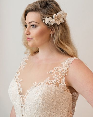 Darcio bridal gown from our curves collection and matching accessories.