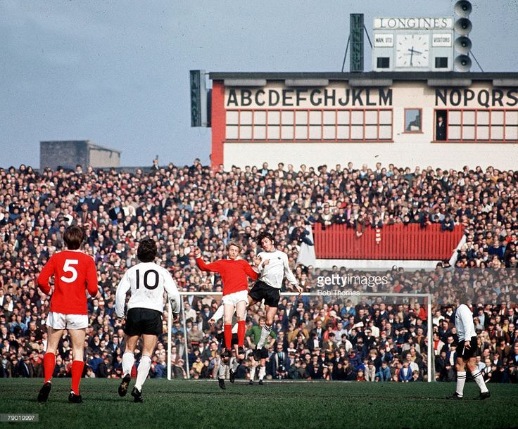 Football, 1971, Manchester United's Denis Law jumps up for the ball with Derby County's Roy McFarland during their league match at Old Trafford