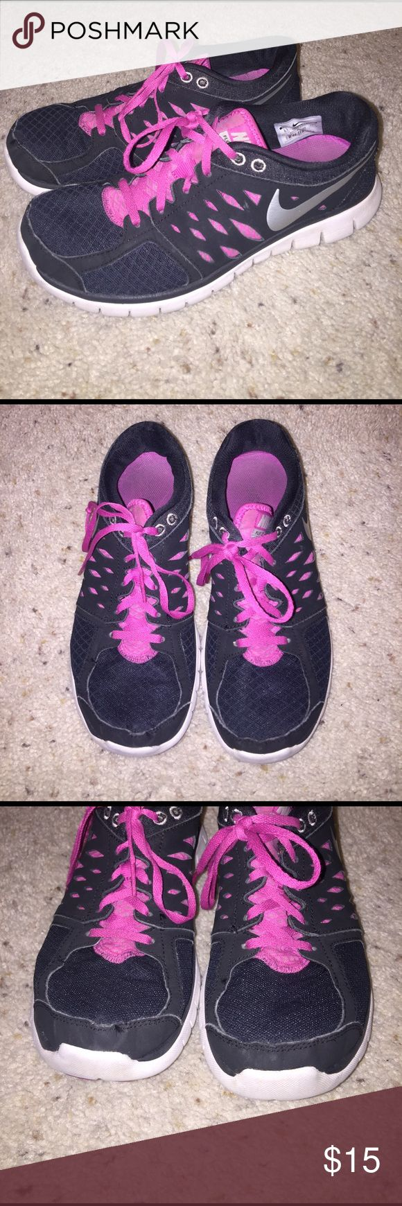 Women's 8.5 Nike Flex Run 2013 Worn a lot. Have scuff marks in the front but no tears (picture included) bottom of both shoes are still in tact. Just the best for working out! Nike Shoes Sneakers