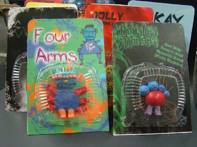 one of the coolest art projects I've seen!  High school art students looked at a class of kinders' monster drawings and in turn create monster figures and packaging and send them back to the kinders.