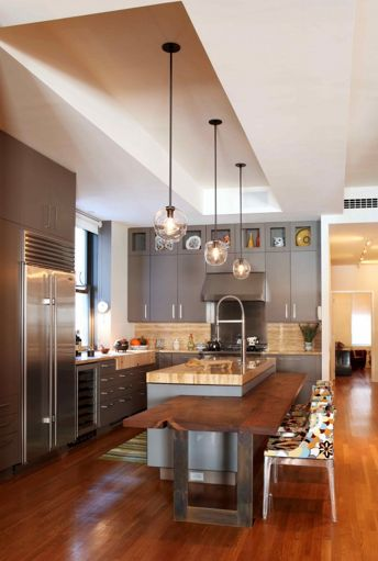 Love the ceiling bulkhead & pendants. Interesting to have a lower brekkie bar with chairs...