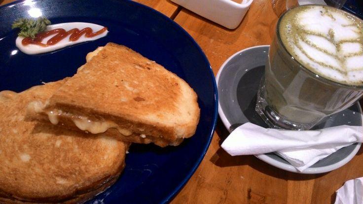 Cheesy bread and hot green tea latte