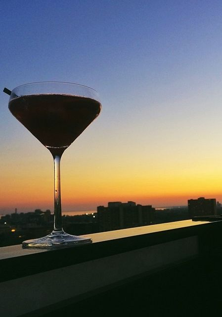 What's in the The Sangria Margarita? El Jimador, Grand Marnier, Fresh Lime Juice, Merlot Float Orange slice, and Strawberry! It can be enjoyed at the Roof Lounge with a the beautiful sunset at @parkhyattto. Photo courtesy of @lammer on Instagram. {Park Hyatt Toronto}