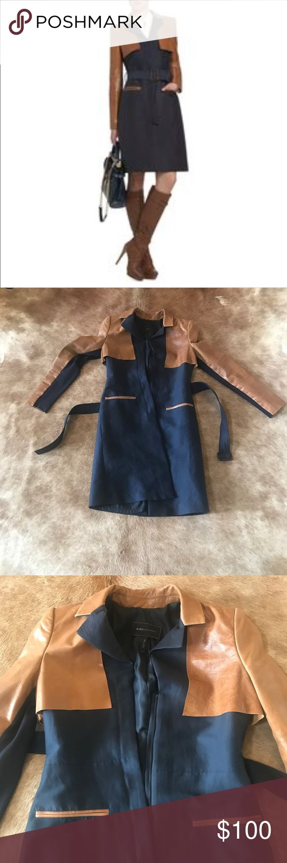 Celene leather contrast trench coat LADIES It's beautiful! My shoulders are just too muscular for it to fit me right. I wore it once. It's been just hanging in my closet mostly. One of the belt loops need a needle & thread but there's no tear. (See last pic) Great condition. Navy & leather BCBG Jackets & Coats