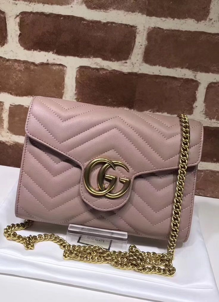 88371a04511 Gucci GG Marmont Pink matelasse mini bag has an excellent metal hardware  which is inspired by