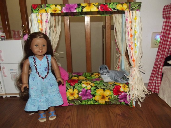 Kanani's bed made from plywood, 1x1 lumber, material, batting, dollar store grass skirts and beads.