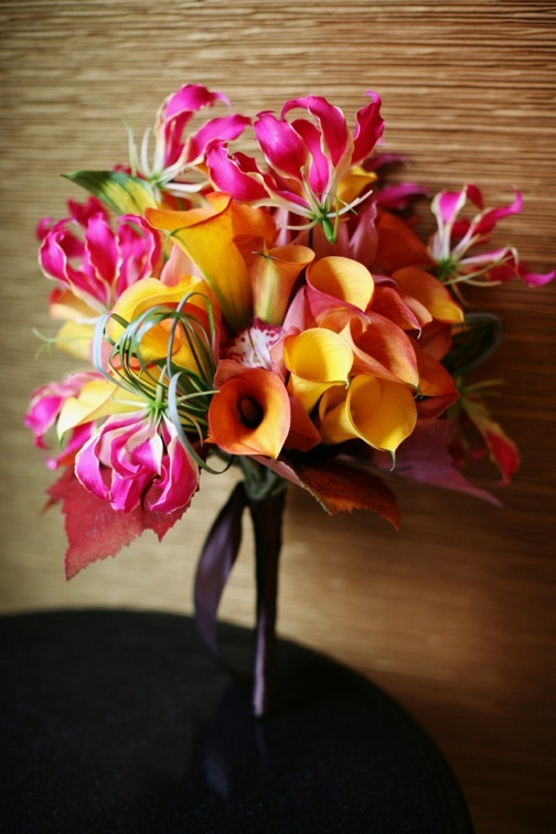 A very sophisticated collection of mini calla lilies, gloriosa lilies with accents of cymbidium orchid blossoms. This was an amazing fall wedding at the Langham  Pasadena
