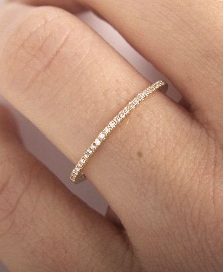 Elegant and simple ring in 14k gold with tiny diamonds. Diamonds go all around. Perfect as a stacking ring. Price is same for size IF YOU WANT A CUSTOM
