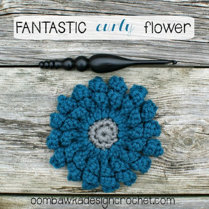 Crochet this fantastic curly flower to embellish your next crochet project! free pattern