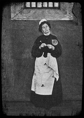 Emmeline Pankhurst, early leader of the British suffragette movement, knits a sock in prison...