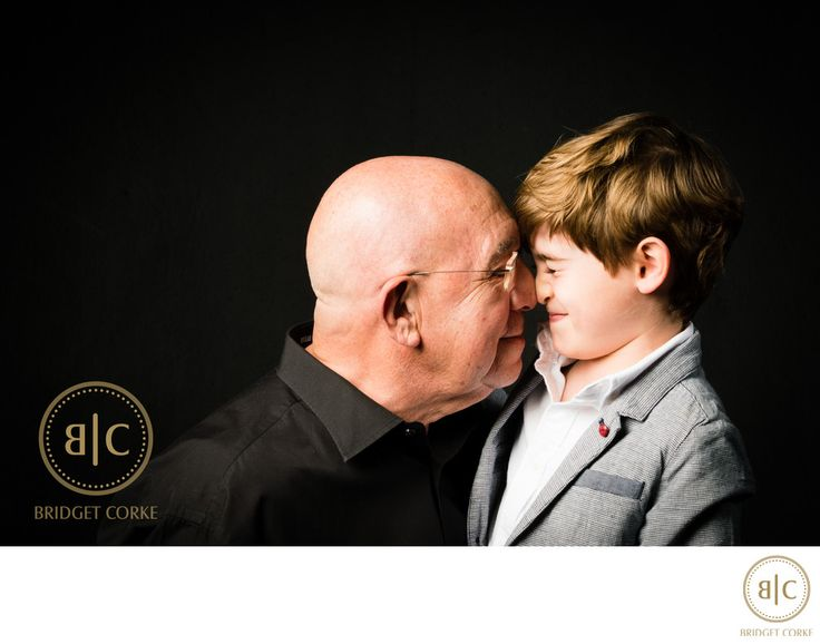 Bridget Corke Photography - Grandfather and Grandson Being Playful:
