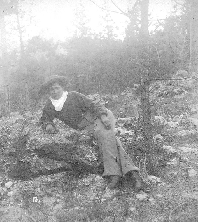 Nineteen-year--old Calamity Jane, in the Black Hills with the Jenney Expedition in 1875, leans on a rock near French Creek