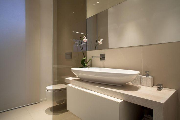 contemporary egg shaped sink in a soft beige bathroom, Villa con Piscina in Catania, Italy by Sebastiano Adragna