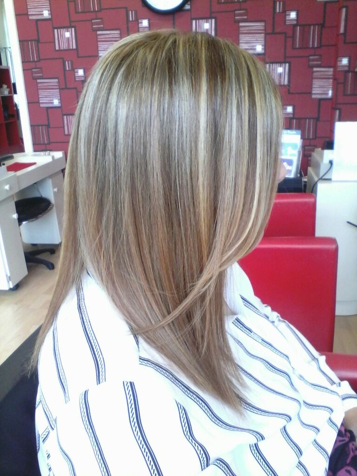 Light golden blonde natural highlights with warm medium brown low lights on long straight hair