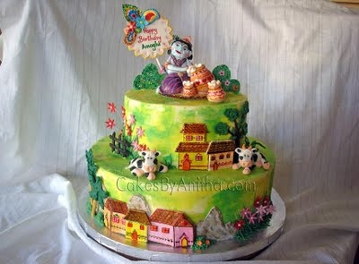 Cakes by Anitha: Lord Krishna Theme cake cute double tiered birthday cake. Krishna figure from fondant.. Not perfect! But cute.