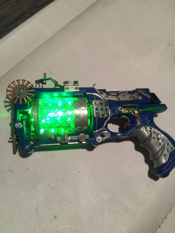 This beauty is more cyberpunk than steampunk but still a mean looking piece. The circuit board in the top easily slides out to reveal the power source of this beauty (a 9 volt battery) and it comes with 5 circuit boards to use interchangeably. This is just a prop, not a real weapon, but it still looks killer. And would be perfect for the next con, cosplay, or even film! Just take a look at it, it speaks for itself. If you have any questions or would like to see more pictures let me know…