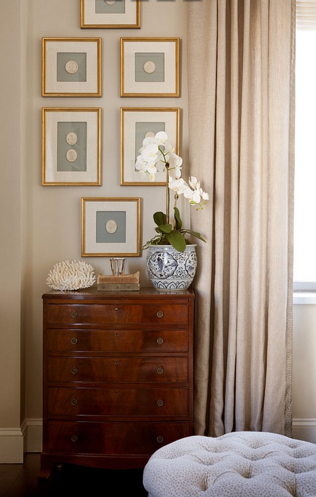 Art above dresser. Elegant space features an antique chest placed under a collection of art in gold leaf frames. #Dresser #Art Jenny Wolf Interiors.