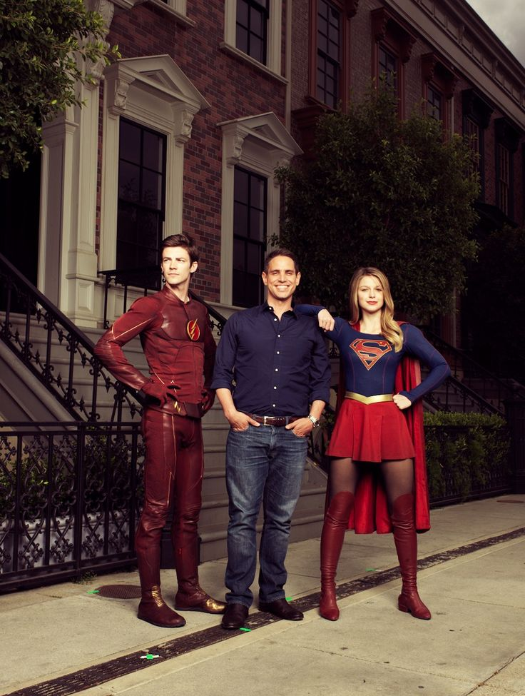 Actor Grant Gustin as The Flash/Berry Allen, producer Greg Berlanti and actress Melissa Benoist as SuperGirl/Kara Zor-El